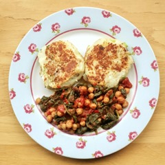 Spicy tomato and chickpeas with spinach and potato cakes